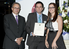Photo of Taylor Anderton receiving the Deutsche Bank Scholarship prize