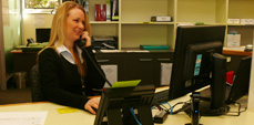 Business and Economics Student Services lady on phone to student